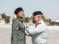 King presents Crown Prince with wings upon completing pilot training