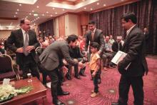 H.R.H. Crown Prince Al Hussein bin Abdullah II greets a young cochlear implant recipient during The Allgau-Orient Rallye closing ceremony, 23rd May 2014