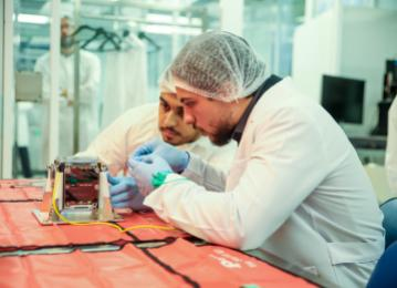 Crown Prince helps assemble final piece of Jordan's first nanosatellite, records audio message to be transmitted from space